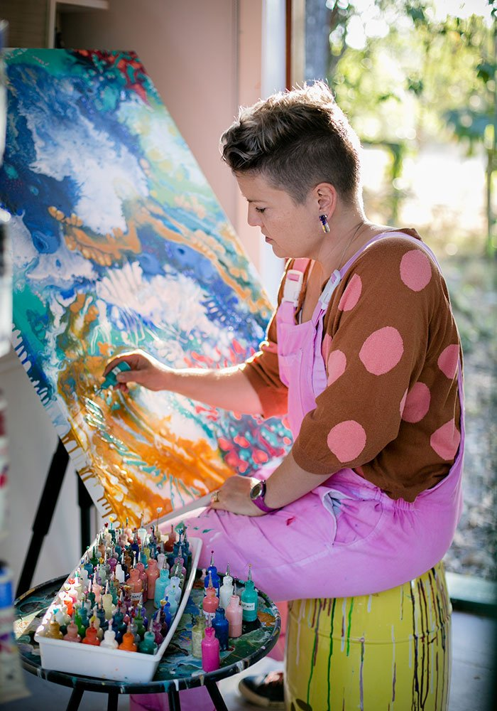 Tina_Dinte_painting_canvas_in_front_of_window
